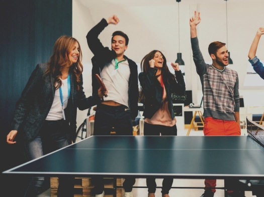 young-business-people-playing-table-tennis-in-their-office-picture-id495698192 (1)